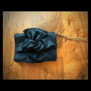 BCBGMaxAzria satin wristlet w/ bow & gold chain